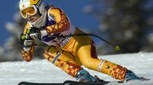 Britt Janyk races down the course in a training run in Lake Louise. (Frank Gunn/THE CANADIAN PRESS)