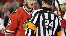 Chicago Blackhawks' Jonathan Toews talks with referee Stephen Walkom (Nam Y. Huh/The Associated Press)
