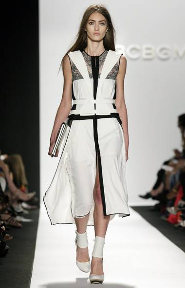 BCBG Max Azria, the label designed by the namesake's wife, head designer and muse Lubov Azria, kicked off the morning with a parade of femme fatales. Inspired by Helmut Newton (timely, too, considering the late photographer's recent retrospective at the Grand Palais in Paris), the show featured graphic harnesses reminiscent of those in Newton's work in white and black leather over BCBG's signature fluid dresses. Lace made an appearance, too, thanks to Azria's continuing obsession with lingerie. The result was the boldest show the mass-market label has seen in years and, apart from a few forced denim pieces and leather trousers (that's right, for summer), it worked. (Richard Drew/AP)