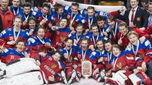 Members of team Russia celebrate their bronze medal victory over Sweden at the IIHF World Junior Championship Thursday, January 5, 2017 in Montreal. (Paul Chiasson/THE CANADIAN PRESS)