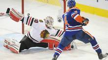 Edmonton Oilers' Taylor Hall scores on Chicago Blackhawks' goalie Corey Crawford during first period NHL hockey action in Edmonton on Saturday, November 19, 2011. THE CANADIAN PRESS/John Ulan (John Ulan/CP)