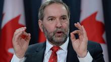 """NDP Leader Tom Mulcair holds a press conference at the National Press Theatre in Ottawa on Monday, Jan 18, 2016. He has denounced U.S. President Donald Trump as a """"fascist,"""" and urged Prime Minister Justin Trudeau to stand up to the American leader on his plan to exclude refugees and some immigrants from the United States. (Sean Kilpatrick/THE CANADIAN PRESS)"""