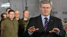 Prime Minister Stephen Harper speaks at the maritime helicopter squadron hangar at CFB Esquimalt on Feb. 22, 2011. (DARRYL DYCK/THE CANADIAN PRESS)