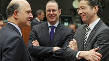 From left, French Finance Minister Pierre Moscovici talks with Swedish Finance Minister Anders Borg and Dutch Finance Minister Jeroen Dijsselbloem during the EU finance ministers meeting in Brussels Feb. 12, 2013. (Yves Logghe/AP)