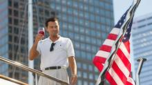 "This film image released by Paramount Pictures shows Leonardo DiCaprio as Jordan Belfort in a scene from ""The Wolf of Wall Street."" (Mary Cybulski/AP)"