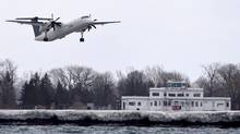 Porter Airline flights taking off from Billy Bishop Toronto City Airport on March 24 2014. (Fred Lum/The Globe and Mail)