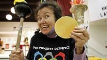 Muriel Marjorie shows off her gold medal during the Poverty Olympics, held to protest against the amount of money spent on the Winter Games, on Feb. 7, 2010 in Vancouver. (ANDY CLARK)