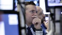 Specialists Frank Masiello, left, and James Denaro work on the floor of the New York Stock Exchange, Wednesday, Nov. 2. (Richard Drew/AP)