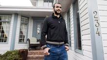 Omar Khadr leaves the home of his lawyer, Dennis Edney, to speak to the media in Edmonton in May, 2015. Mr. Khadr was accused of throwing a grenade that killed a U.S. Army medic in Afghanistan in 2002. (Nathan Denette/The Canadian Press)