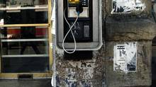 An old payphone on Queen St. West in Toronto. The CRTC has denied a request by Bell to increase payphone call prices, in a decision that could hasten the demise of payphone. (Louie Palu/The Globe and Mail)