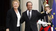 France's President François Hollande speaks with Quebec's Premier Pauline Marois after their meeting at the Elysée Palace in Paris on Monday. (BENOIT TESSIER/REUTERS)