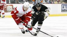 Detroit Red Wings forward Gustav Nyquist chases the puck ahead of Pittsburgh Penguins left wing Jussi Jokinen during the first period at the CONSOL Energy Center. (Charles LeClaire/USA Today Sports)