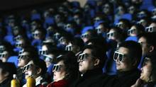Audience members watch a movie through 3D glasses at a newly opened IMAX theatre on February 8, 2007 in Wuhan of Hubei Province, China. (China Photos/Getty Images)