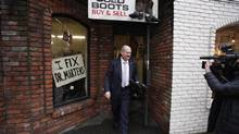 B.C. Finance Minister Mike de Jong leaves Olde Towne Shoe Repair after having the soles replaced on his shoes in Victoria on Feb. 17, 2014, a day ahead of budget day. (Chad Hipolito/The Canadian Press)