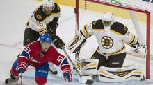 Montreal Canadiens' David Desharnais (51) is pushed over by Boston Bruins' Kevan Miller (86) as Bruins' goaltender Malcolm Subban defends his net during second period NHL preseason action in Montreal, Monday, September 16, 2013. (Graham Hughes/THE CANADIAN PRESS)