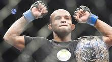 Demetrious Johnson holds the winning belt after defeating Joseph Benavidez during the flyweight championship title bout at UFC 152 in Toronto on Saturday, Sept. 22, 2012. (The Canadian Press)
