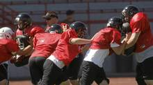 The McMinnville High School football team practices Monday, Aug.23, 2010, in McMinnville, Ore. (AP Photo/Rick Bowmer/AP Photo/Rick Bowmer)