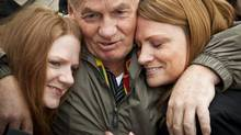 Ivan Henry hugs his two daughters Tanya, left, and Kari after he was acquitted of eight counts of rape from a conviction in 1983 which sent him to prison for 27 years. The photograph was taken in Vancouver in October, 2010. (JOHN LEHMANN/The Globe and Mail)