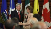 Prime Minister Stephen Harper shakes hands with Government Leader in the Senate Marjory LeBreton after delivering a speech during a Conservative caucus meeting on Parliament Hill in Ottawa on May 21, 2013. (Chris Wattie/Reuters)