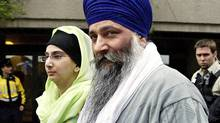 Ajaib Singh Bagri leaves B.C. Supreme Court in Vancouver, B.C. with his daughter after he was found not guilty in the bombing of an Air India flight 182 in 1985, Wednesday, March 16, 2005. (Richard Lam/The Canadian Press/Richard Lam/The Canadian Press)