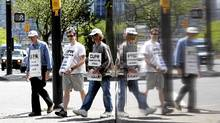 It seems that management and government alike are allowed to argue that the post office is either really important or not very important at all. (The same double-speak applied to the Air Canada strike.) (Jason Lee/Reuters/Jason Lee/Reuters)