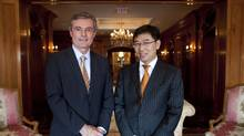 Ed Frackowiak, Chairman and CEO of Wescast Industries Inc. left, and Dong Ping, Chairman and CEO of Sichuan Bohong Industry Co., right, pose for a photo in Toronto, Ont. Monday, September 12, 2011. (Brett Gundlock/Brett Gundlock For The Globe and Mail)