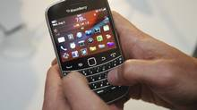 A person uses the new Blackberry Bold 9900 at a release party to promote the BlackBerry OS 7 devices in Toronto Aug. 3, 2011. (Mark Blinch/Reuters/Mark Blinch/Reuters)