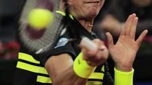 Milos Raonic returns the ball to Rafael Nadal during the semifinal of the Barcelona open tennis in Barcelona, Spain, Saturday, April 27, 2013. Nadal won 6-4, 6-0. (Manu Fernandez/AP)