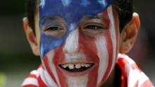A young Atletico Madrid fan with his face painted in the team colors waits outside the hotel where his team will stay for the Champions League final in Lisbon, Portugal, Friday, May 23, 2014. (Associate Press)