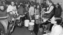 sale held at Rochdale College August 26, 1971, to raise funds for legal fees they believe will be needed when Central Mortgage and Housing (CMHC) assume management. Established by an act of the Ontario Legislature in 1964, Rochdale College became Canada's first free university and the largest of over 300 such free universities in North America. Rochdale was an experiment in student-run alternative education and co-operative living in Toronto. It provided space for 840 residents in a co-operative living space when it opened in 1968. The project ultimately failed when it could not cover its financing and neighbours complained that it had become a haven for drugs and crime. It was closed in 1975. (John Wood For The Globe and Mail)