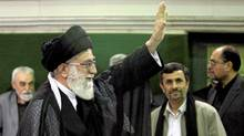 Iranian supreme leader Ayatollah Ali Khamenei, left, waves to his well wishers, unseen, as President Mahmoud Ahmadinejad, second right, looks on, in a religious ceremony, in Tehran, Iran on Saturday, May 7, 2011. (STR/The Associated Press)