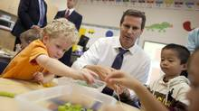 Premier Dalton McGuinty builds necklaces with Nathan Skinner, 3, left, and Alex You, 4, in a full day kindergarten class at Stoney Creek Public School in London, Ontario, October 8, 2010. (Geoff Robins for The Globe and Mail/Geoff Robins for The Globe and Mail)