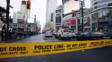 Police tape is seen in front of the Toronto Eaton Centre shopping mall in Toronto on June 2, 2012 after a shooting in the food court. (MARK BLINCH/REUTERS)