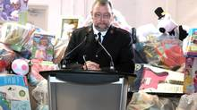 Major John Murray of the Salvation Army attends a news conference at their Railside Road food and toy distribution centre in Toronto on Wednesday, November 21, 2012, after discussing the alleged theft of several million dollars worth of items. (Chris Young/The Canadian Press)