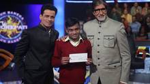 Manoj Bajpai, Manoj Kumar and Amitabh Bachchan with his cheque at the end of the show.