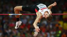 Canadian high jumper Derek Drouin is happy to have training partners for the first time since he was in college, where he won five NCAA outdoor and indoor titles. (Ian Walton/Getty Images)