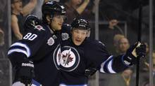 Winnipeg Jets' Nik Antropov (80) and Antti Miettinen (20) celebrate Antropov's goal against the Washington Capitals during second period NHL action in Winnipeg on Friday, March 16, 2012. (JOHN WOODS/THE CANADIAN PRESS)