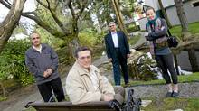 (L-R) Yousef Mohammadi, Carlos Ruiz, Kevin Anjam, and Kasia Gagnon pose for a portrait in the courtyard of their condo complex in North Vancouver on April 9th, 2012. The tenants were part of a group who contributed to a court decision to block the sale of their complex, known as Cypress Gardens, to a developer (Simon Hayter/The Globe and Mail)