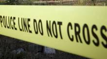 Police tape demarking a crime scene. (JOHN LEHMANN/The GLOBE AND MAIL)
