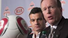 New Toronto FC head coach Ryan Nelsen (left) listens as club president Kevin Payne speaks to the media in Toronto on Tuesday January 8, 2013. (Frank Gunn/THE CANADIAN PRESS)