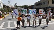 A group of young people parody U.S. Republican presidential candidate Mitt Romney's last name by intentionally misspelling it as R-MONEY as they march in a Fourth of July parade in Takoma Park, Md., on July 4, 2012. (Jim Bourg/Reuters)