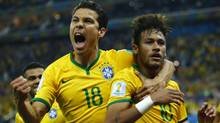 Brazil's Hernanes, left, and Neymar celebrate after Neymar scored a goal from a penalty kick during the 2014 World Cup opening match against Croatia at the Corinthians arena in Sao Paulo June 12, 2014.  (Reuters)