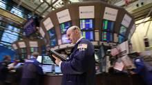 Traders work on the floor of the New York Stock Exchange. (BRENDAN MCDERMID/BRENDAN MCDERMID/REUTERS)