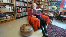 Poet and educator Mary Dalton reads in her office at Memorial University of Newfoundland. (pd/Paul Daly)