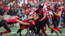 Stampeders quarterback Bo Levi Mitchell runs the ball during Sunday's game against the Redblacks in Ottawa. (Sean Kilpatrick/THE CANADIAN PRESS)
