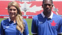 Former Canadian international soccer player Kara Lang (left) and Toronto FC defender Doneil Henry model the retro uniform that the Canadian men's and women's soccer teams will wear for one game apiece in June to mark the 100th anniversary of the Canadian Soccer Association, in Toronto, Thursday, May 10, 2012. (Neil Davidson/THE CANADIAN PRESS/Neil Davidson/THE CANADIAN PRESS)