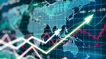 Business chart with glowing arrows and world map (peshkov/Getty Images/iStockphoto)