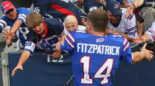 Ryan Fitzpatrick #14 of the Buffalo Bills celebrates with fans after defeating the New England Patriots at Ralph Wilson Stadium on September 25, 2011 in Orchard Park, New York. Buffalo won 34-31. (Photo by Rick Stewart/Getty Images) (Rick Stewart/2011 Getty Images)