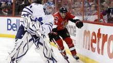 Ottawa Senators' Colin Greening collides with Toronto Maple Leafs goalie James Reimer (L) during the second period of their NHL hockey game in Ottawa March 17, 2012. (BLAIR GABLE/REUTERS)