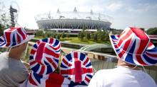 Spectators wearing hats in British national colours look at the Olympic Stadium in the Olympic Park during the London 2012 Olympic Games, August 11, 2012. (Reuters)